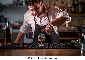 Bartender is pouring alcohol