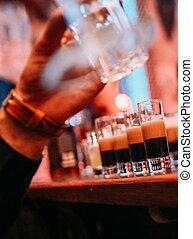 bartender makes cocktails nightclub group friends