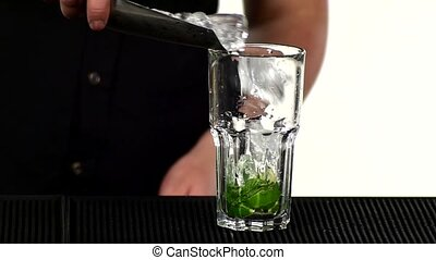 Bartender making and decorating cocktail. slow motion