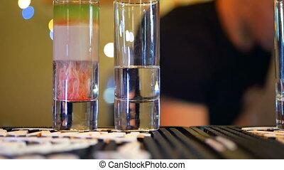 Bartender making cocktail - Bartender is making cocktail and...
