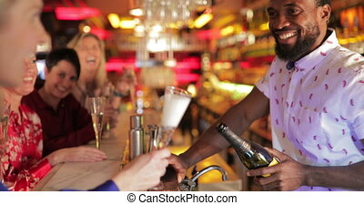 Bartender Pouring a Glass of Prosecco - Panning shot of a...