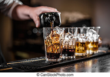 Bartender pouring alcoholic drink
