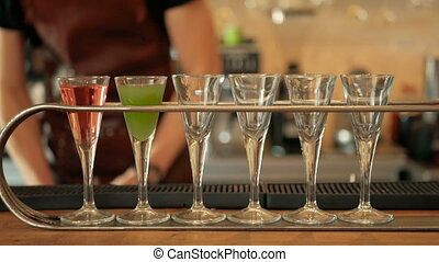 Bartender Pouring Colorful Alcoholic Drink into Shot...