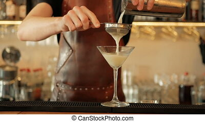 Bartender pouring liquor into shaker for cocktail. Restaurant Cocktail preparation step by step