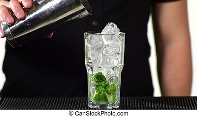 bartender preparing mojito cocktail drink, slow motion. close up