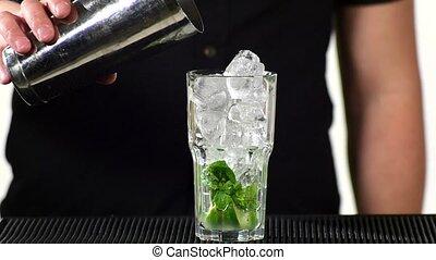 bartender preparing mojito cocktail drink, slow motion. close up