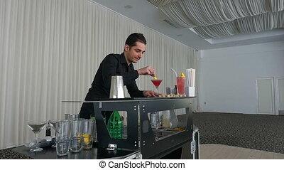 Bartender serving cocktail drink in slow motion at a bar