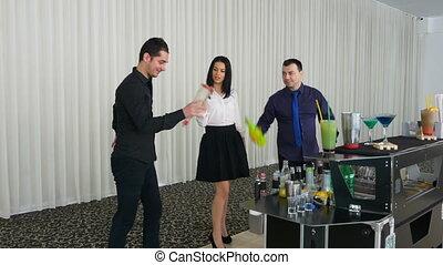 Bartender teaching girl flair bartending techniques