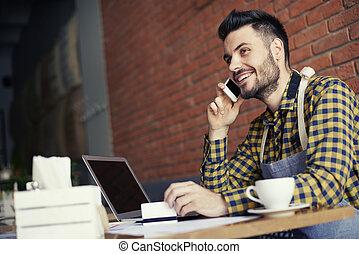Bartender using wireless technology over coffee break