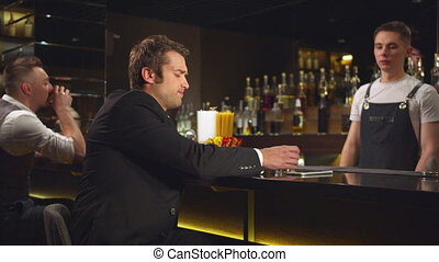 Bartender wakes up sleeping at the bar man, man goes away