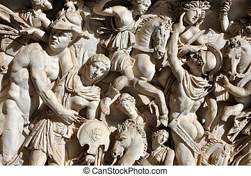 Bas-relief and sculpture of ancient Roman warriors