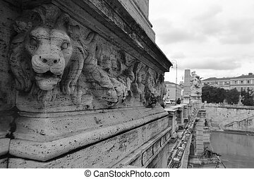 Bas relief of a lion on the bridge in Rome, Italy. Black and white.