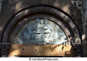 Bas relief of a sacred image, Margaret Island, Budapest.