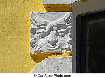 Bas-relief with depicting mythical creature on the old historical building of eighteenth century AD
