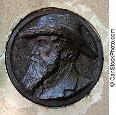 bas-relief with portrait of man