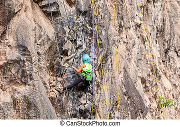 Basalt Challenge Of Tungurahua, Hispanic Girl Climbing A Rock Wall