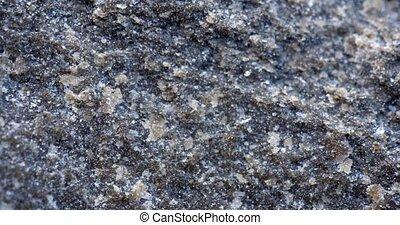 Closeup of a natural, coarse basalt rock matrix with crystals of quartz and calcite throughout.