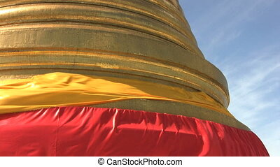 Base Of A Temple Spire - Red and orange ribbons blow in in...
