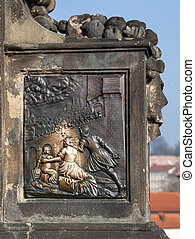 Base of John of Nepomuk statue on the Charles bridge, Prague, polished from touching for good luck