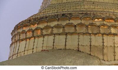 Base of The Kyaiktiyo Pagoda - Handheld, panning, close up...