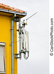 Base station - Mobile network base station on the top of the...