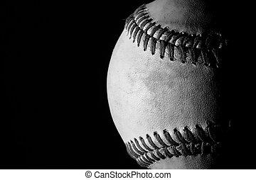 Baseball - A used baseball on a black background