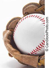 Baseball and Baseball Glove - A baseball inside of a...
