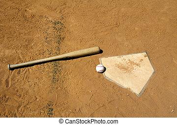Baseball and Bat on Home Plate - Baseball and bat on home...