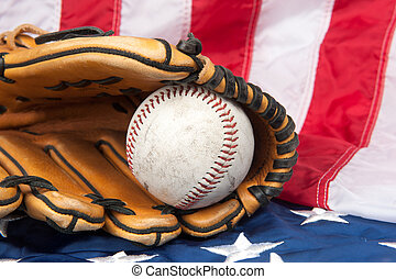 Baseball and glove on American flag