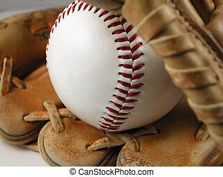 Baseball and Mitt - Macro shot of a baseball and mitt with a...
