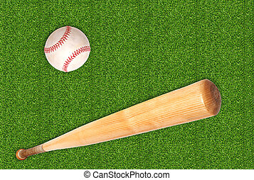 baseball ball and bat on green grass background
