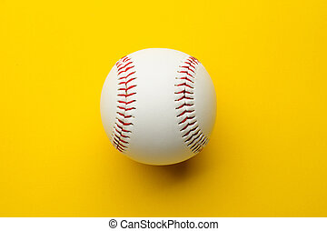 Baseball ball on yellow background with copy space