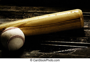 Wooden baseball bat and baseball on a black background