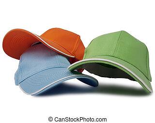 three baseball caps isolated on white background