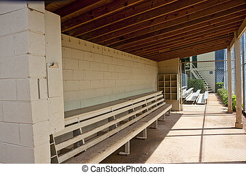 An Empty Baseball Dugout At A Local Ball Field