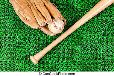Baseball equipment on artificial green grass turf field