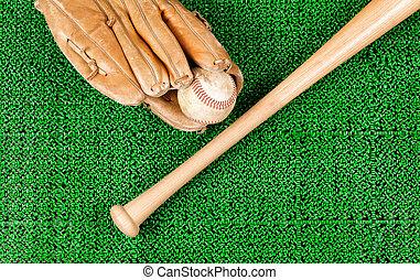 Baseball equipment on artificial green grass turf field
