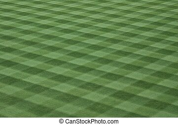 Photographed grass turf field at major league baseball game.