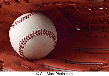 Baseball glove and ball.