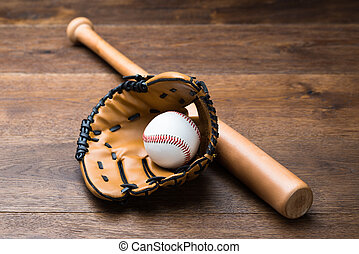 Baseball Glove And Ball With Bat On Table