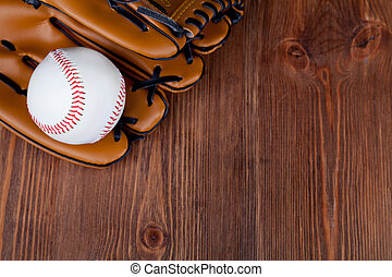 Baseball glove - Baseball and mitt on rustic wooden ...