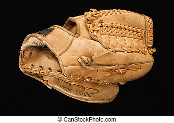 Baseball glove. - Baseball glove on black.