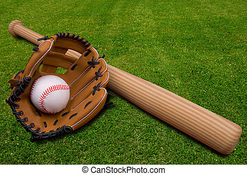 Baseball glove, bat and ball on grass