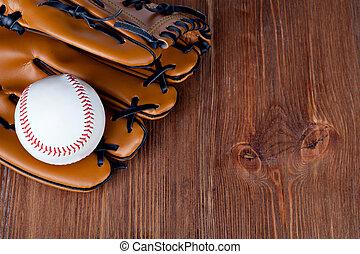 Baseball glove - Baseball and mitt on rustic wooden...