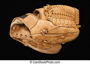 Baseball glove. - Baseball glove on black.
