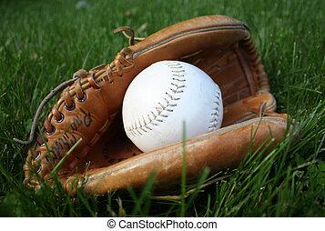 Baseball in glove - Baseball or softball in a glove in the...