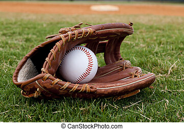 Baseball in Old Glove on Field