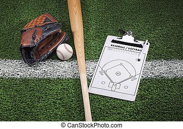 Baseball mitt, bat and clipboard on grass with stripe -...
