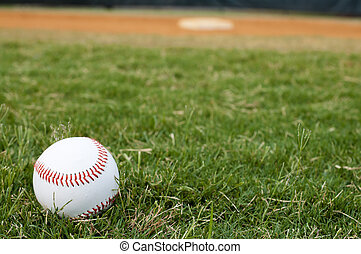Baseball on Field - Baseball on field with base and outfield...