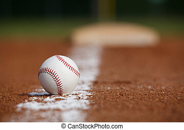 Baseball on the Infield Chalk Line with the Base in the ...